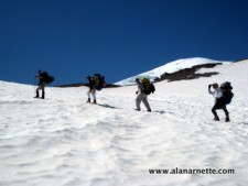 Team climbing the InterGlacier on Mt. Rainier