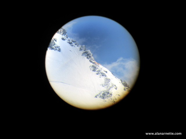 Camp 3 through a telescope from K2 Base Camp
