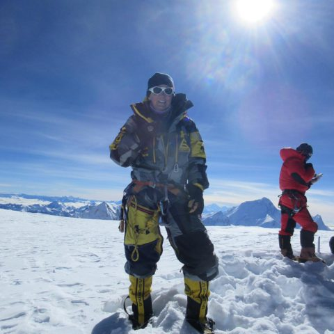 Tracee Metcalfe on Cho Oyu Summit with Everest behind