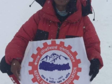 Mingma Dorjee Sherpa, son of Kami Sherpa on the summit Everest 2019